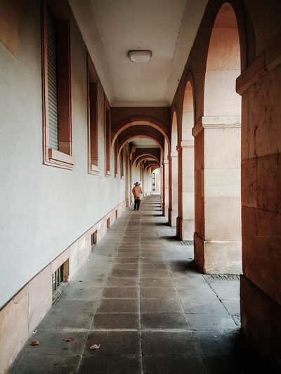 Architecture Direction Built Structure Arcade The Way Forward Arch Corridor Indoors  Building Real People Diminishing Perspective Architectural Column In A Row Walking One Person Day Incidental People Ceiling Rear View Colonnade Picoftheday Photooftheday Architecture_collection Justgoshoot