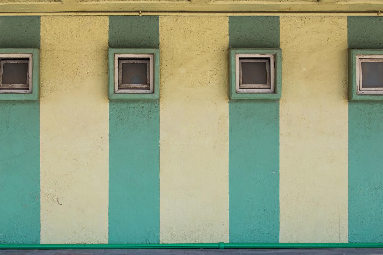 Windows On Striped Wall