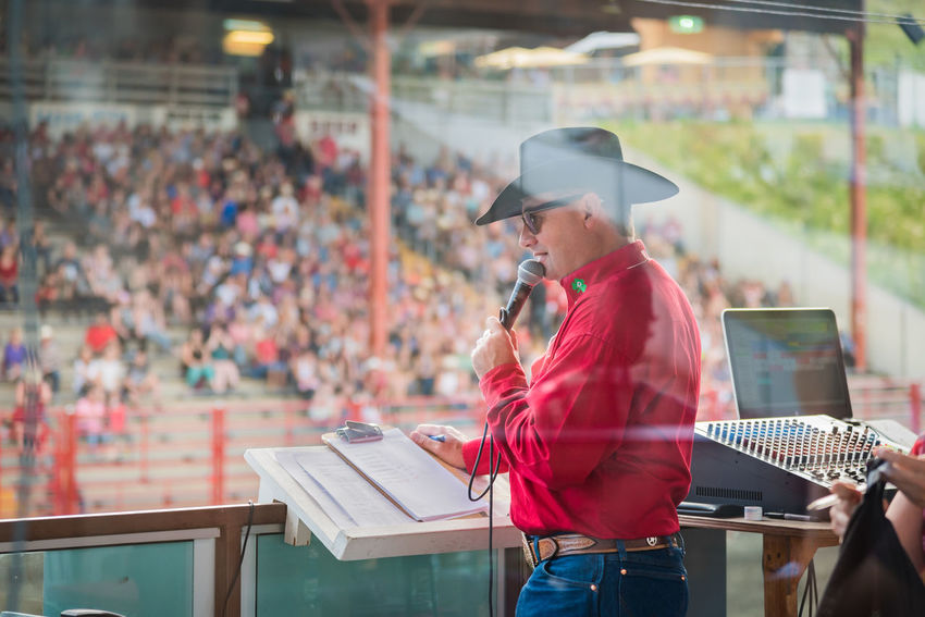 Williams Lake, British Columbia/Canada - July 1, 2016: rodeo announcer Tyson Pietsch at work during the 90th Williams Lake Stampede, one of the largest stampedes in North America. 90th Williams Lake Stampede British Columbia, Canada Event MC Man Rodeo Spectators Travel Tyson Pietsch Audience Candid Country Western Crowd Documentary Editorial  person Portrait Professional Rodeo Rodeo Announcer Sound Booth Stampede Stampede Grounds Stands Tourism Western Dress