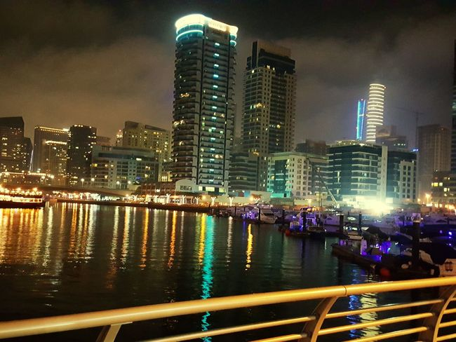 City Night Illuminated Skyscraper Reflection Building Exterior Architecture Cityscape Urban Skyline River Bridge - Man Made Structure City Life Sky Outdoors Neon Multi Colored Built Structure Modern Travel Destinations Nightlife Excitement Beauty In Nature Nature Shadow Colours