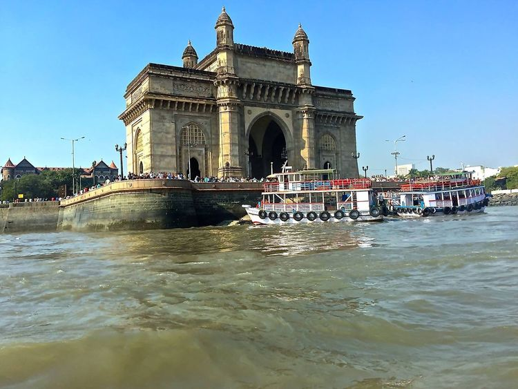 The Gateway of India. Architecture Built Structure Building Exterior Travel Destinations Water Tourism Large Group Of People Outdoors Travel Boats Speedboat Gatewayofindia National Landmark Monument Waterfront Waves