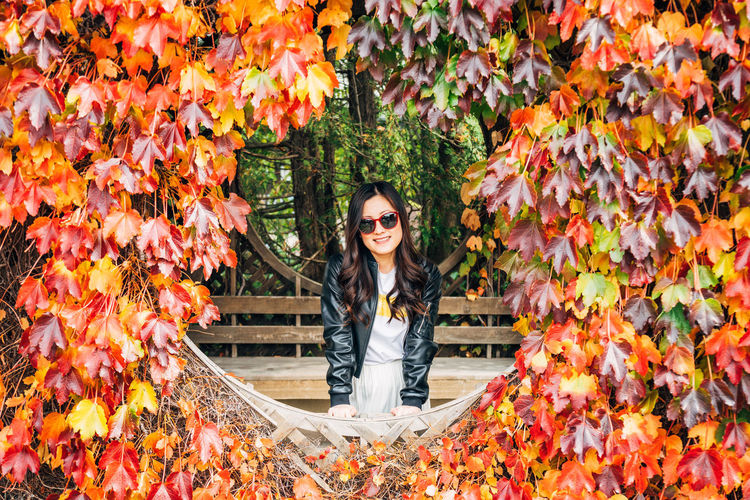 Autumn Looking At Camera Portrait One Person Young Adult Change Plant Part Leaf Front View Smiling Plant Nature Young Women Orange Color Day Lifestyles Real People Adult Outdoors Hairstyle Beautiful Woman