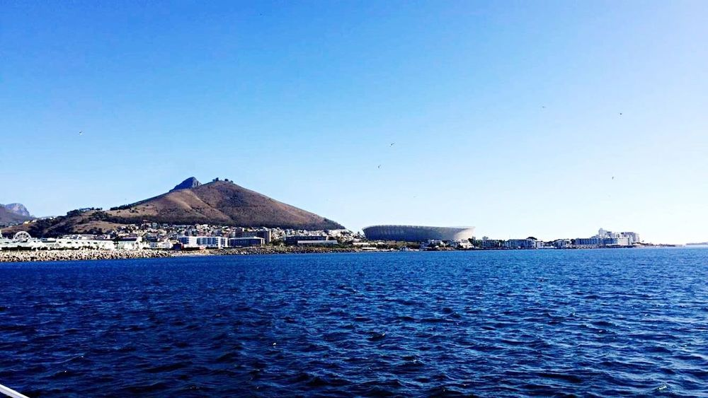 Cape Town Stadium Waterfront Blue Water Clear Sky Rippled Sea Mountain Tranquil Scene Scenics Tranquility Water Surface Beauty In Nature Seascape