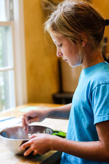 Close-up of girl in kitchen