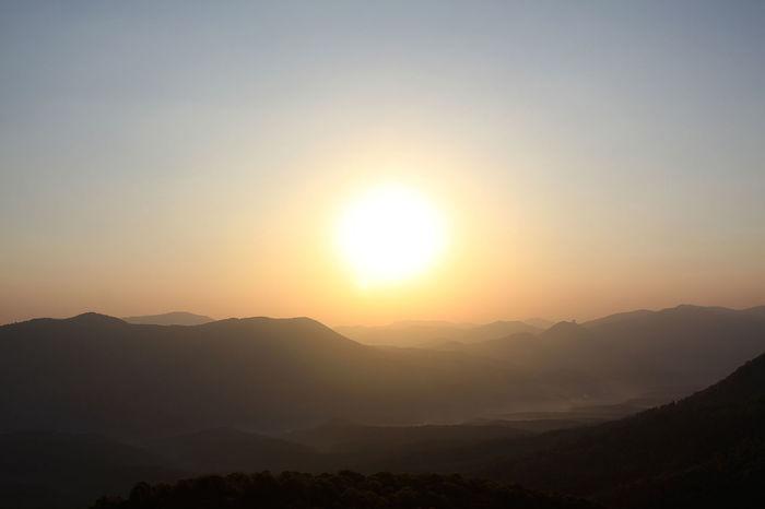 Sunrise Beauty In Nature Idyllic Landscape Mountain Mountain Range Nature No People Outdoors Scenics Silhouette Sky Sun Sunlight Sunrise