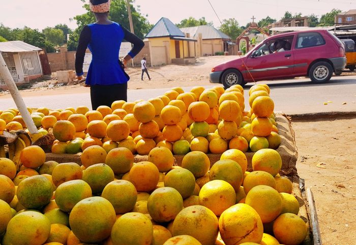 Fruit Freshness Yellow Outdoors One Person Young Adult Northern Nigeria Africa Day To Day Streetphotography Jimeta
