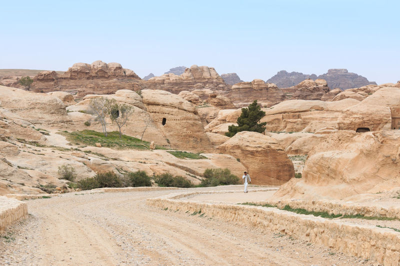 Ruins of Petra in Jordan Arid Climate Beauty In Nature Desert Destination Geology Heat Jordan Landmark Landscape Mountain Nature Non-urban Scene Petra Physical Geography Remote Road Rock - Object Rock Formation Ruins Scenics Summer The Way Forward Touristic Tranquil Scene Tranquility
