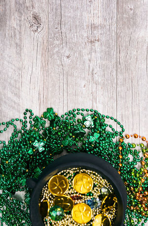 St. Patrick's Day series with lots of copyspace around beads, green beer and pots of gold. Green Holiday Pot Of Gold Saint Patrick's Day St. Patrick's Day St. Patricks Day St. Pattys Day Wood Background Irish No People Poster Background Pot