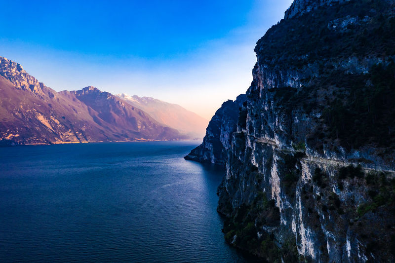 Strada del Ponale DJI X Eyeem Aerial Photography Dronephotography Mountain Peak Formation Outdoors Rock - Object Sunset Rock Formation Waterfront No People Idyllic Blue Mountain Range Sea Nature Non-urban Scene Rock Tranquility Water Tranquil Scene Sky Scenics - Nature Beauty In Nature Mountain