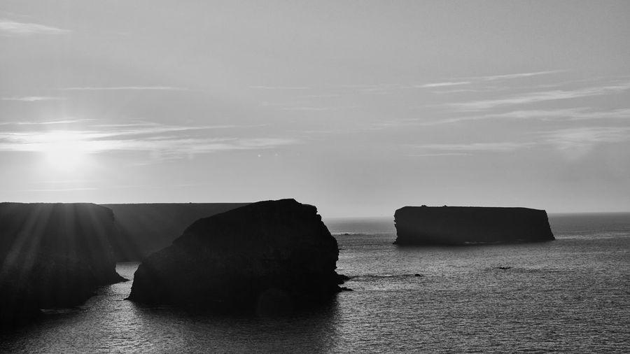 Rocks on sea against sky