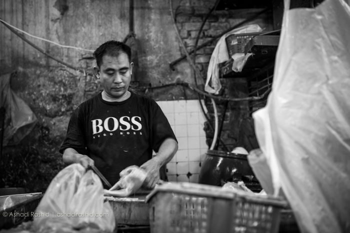 Chicken Butcher Adult Black And White Butterfly Chicken Burger Day Horizontal Indoors  Occupation One Man Only One Person Only Men People Person Portrait Real People Small Business Waist Up Young Adult