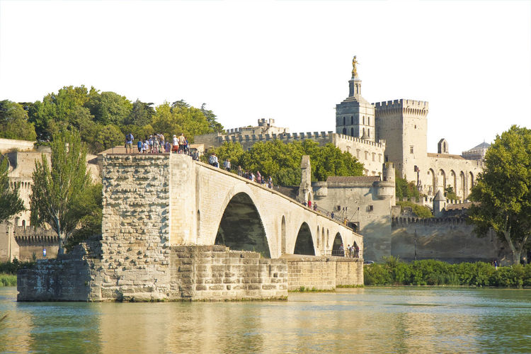 Avignon city with the ancient medieval Saint Benezet bridge Avignon Avignon City Arch Arch Bridge Architecture Avignon Bridge Bridge Bridge - Man Made Structure Building Building Exterior Built Structure Clear Sky Connection History Nature No People Outdoors Plant River Sky The Past Travel Destinations Tree Water Waterfront