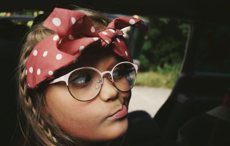Portrait of girl in car