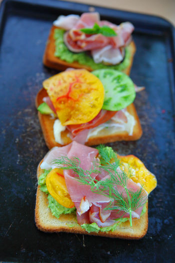 Avocado, tomato and prosciutto sandwiches on toast Food Open-faced Sandwiches Prosciutto Freshness Healthy Eating Indoors  Ready-to-eat Close-up No People Meal Breakfast Snack Bread Slices Heirloom Tomatoes Dill Avocado Overhead Natural Light Lunch Brunch Cured Meat Vertical Delicious Figs