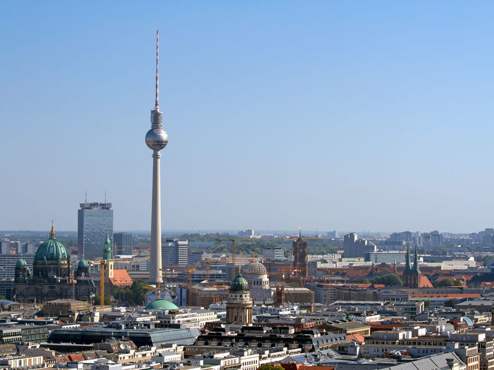 Fernsehturm and berlin cathedral in city against clear sky