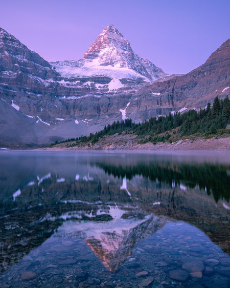 Dawn reflection of Mount Assiniboine (3,618m or 11,870ft) over Magog Lake. I took this shot after spending most of the night up on Nub Peak and descending with head torches. Somehow still awake thanks to a delirious mix of caffeine and adrenalin. The landscapes around Mt Assiniboine have to be one of the most beautiful parts of the world I have shot in. Mount Assiniboine Provincial Park, British Columbia, Canada. Water Mountain Scenics - Nature Beauty In Nature Tranquil Scene Lake Tranquility Reflection Mountain Range Environment Nature Cold Temperature Sky No People Waterfront Winter Snowcapped Mountain Outdoors Mountain Peak Mount Assiniboine Magog Lake Dawn Of A New Day Glacier Sunrise Alpine Landscape