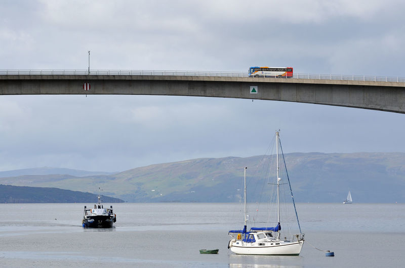A bus heads over the Skye bridge -photographed from Kyleakin, Isle of Skye Boat Bridge Bridge - Man Made Structure Bus Coach Highlands Journey Mode Of Transport Mountain No People Scotland Sea Ship Skye Skye Bridge Transportation Water Yacht