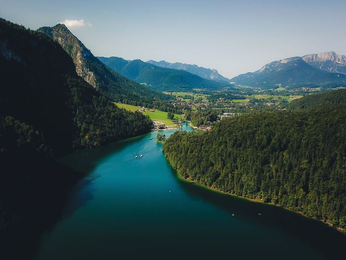 Mountain Scenics Nature High Angle View Beauty In Nature Tranquil Scene Mountain Range Water Tranquility River Transportation Outdoors Sky No People Day Nautical Vessel Landscape Tree Road Clear Sky Lost In The Landscape Connected By Travel Dronephotography Lake View Königssee Perspectives On Nature The Great Outdoors - 2018 EyeEm Awards