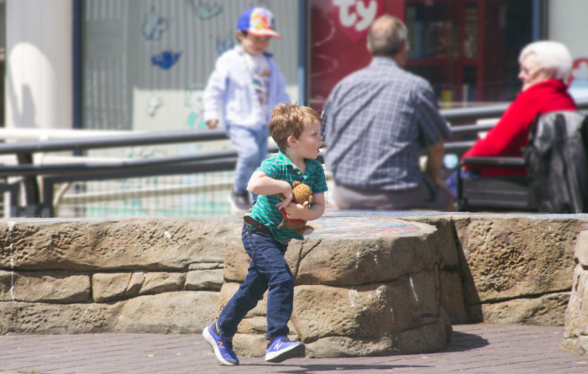Having a little run at Lonsdale Quay in North Vancouver. Lonsdale Quay North Vancouver,BC Child Full Length Childhood Males  Boys Playing Togetherness Son Sunlight Preschool Age