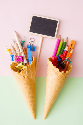 Green Kids Pink Sign Back To School Blank Childhood Close-up Colored Pencil Concept Cone Desk Organizer Education Gackground Indoors  Multi Colored No People Pencil Pencil Sharpener Play School Still Life Studio Shot Variation White Background