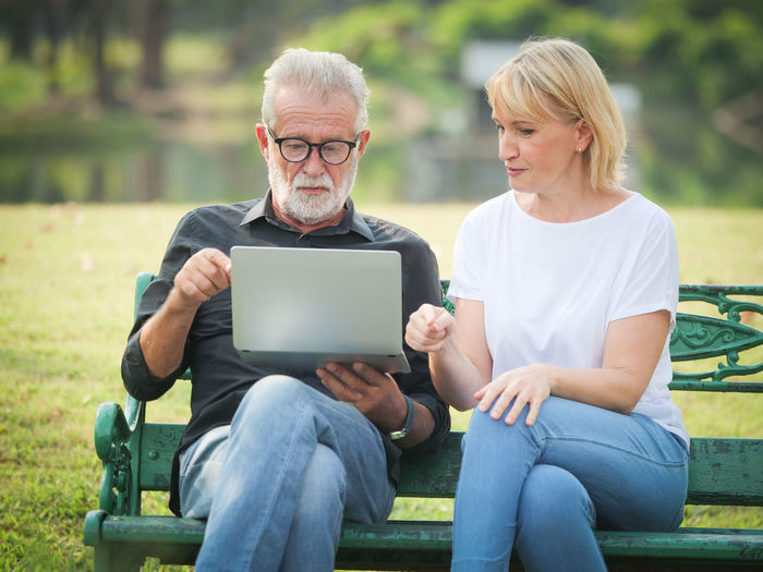 Adult Age Aged Background Beautiful Bench Caucasian Couple Couple.computer Elderly Family Female Green Happy Health Internet Lady Laptop Lifestyle Love Male Man Mature Natural Nature Old Older  Online  Outdoors Park Pensioner People person Portrait Retired Retirement Romance Senior Sitting Space Spring Summer Together Two White Woman