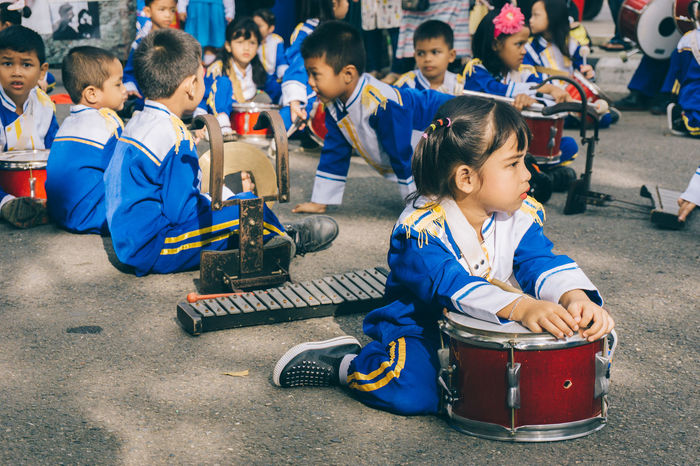 marching band Blue Boys Carnival Crowds And Details Child Childhood Children Only Crowd Day Education EyeEmNewHere Girls Instruments Kids Large Group Of People Marching Band Marching Band Instruments Outdoors People Sitting Street Street Photography Waiting Women Around The World The Street Photographer - 2017 EyeEm Awards The Photojournalist - 2017 EyeEm Awards