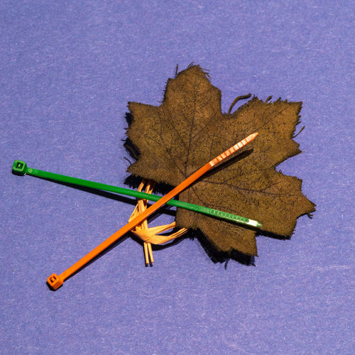 crafting with cable ties Studio Shot Indoors  Colored Background No People Art And Craft Pencil Close-up Shape Map Multi Colored Still Life High Angle View Creativity Blue Background Blue Craft Wood - Material Paper Textured  Design CableTies Crafting Leaf Rafia
