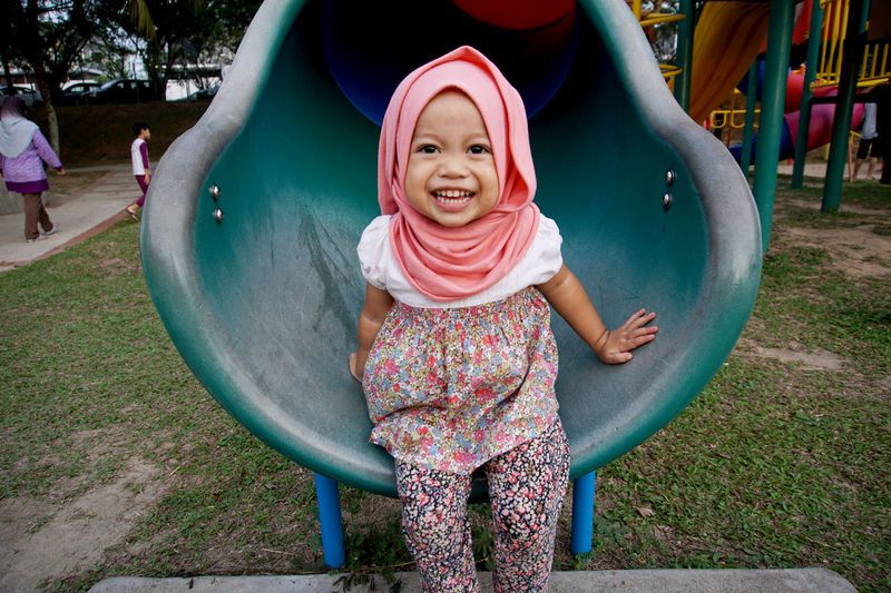 Casual Clothing Child Childhood Cute Day Elementary Age Enjoyment Front View Full Length Fun Girls Happiness Innocence Leisure Activity Lifestyles Looking At Camera Outdoors Park - Man Made Space Person Playful Portrait Smiling Vacations Muslim Child Muslimahtoday