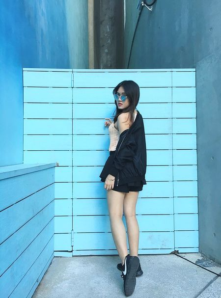 Young Adult Only Women One Young Woman Only Young Women Leaning Fashion One Person Standing One Woman Only Brown Hair Portrait Adult Door Sunglasses Cool Attitude Casual Clothing Adults Only Beautiful Woman Full Length Long Hair