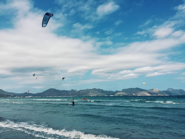 Kitesurfing Balearic Islands Pollença Majorca Flying Sea Sky Vacations Kiteboarding Cloud - Sky Water Leisure Activity Unrecognizable Person Scenics Parachute Adventure Paragliding Tranquil Scene Sport Mountain Tranquility Extreme Sports Beauty In Nature
