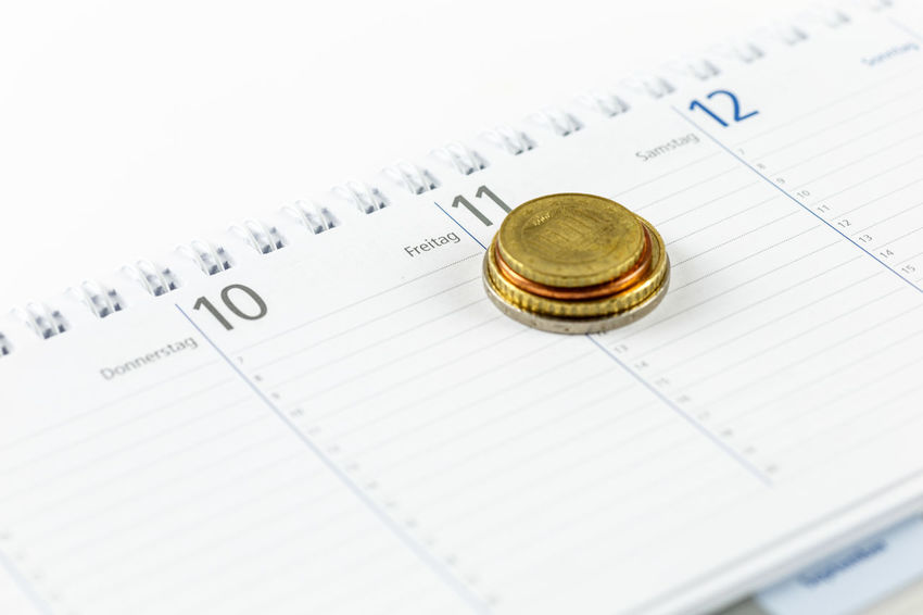 Close-up Finance Paper No People Number Education Still Life Selective Focus Wealth Business Document Studio Shot Publication Indoors  Text Book Currency Coin Investment Full Frame Calender