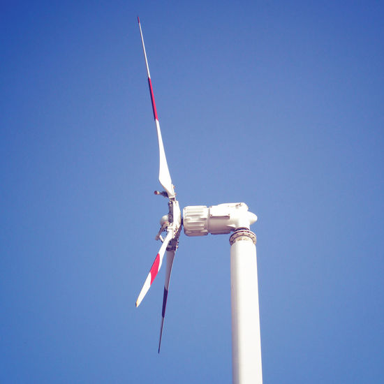 Sky Clear Sky Blue Low Angle View Nature Air Vehicle Airplane Day No People Motion Copy Space Flying Travel White Color Mode Of Transportation Outdoors on the move Sunlight Turbine Transportation Vapor Trail National Icon Plane Windmill