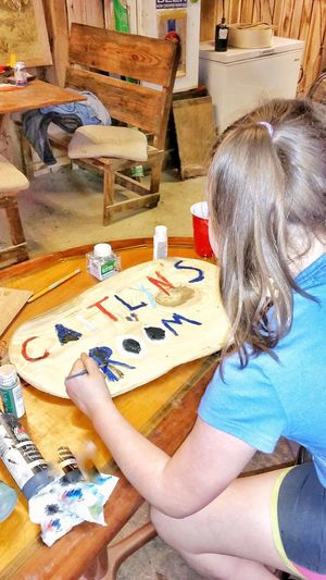 Table Indoors  Sitting Leisure Activity Real People Chair One Person Lifestyles Day Human Hand Close-up People Adult Art ArtWork Art And Craft Painting Name Text Words Letters Making Art Child Learning Art Budding Artist The Secret Spaces