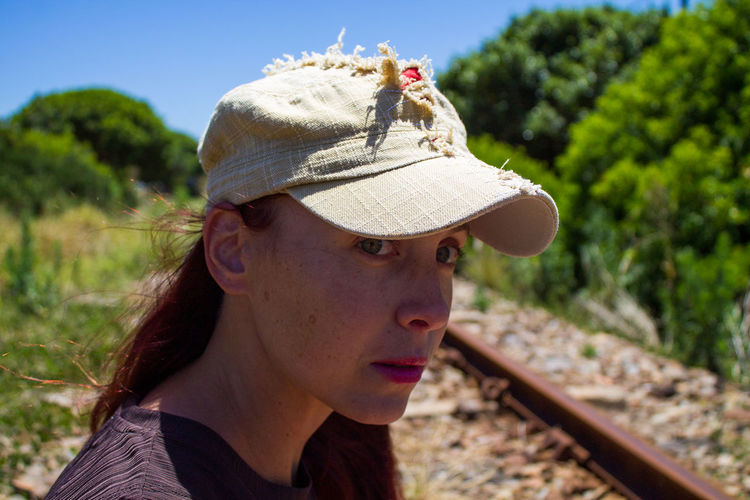 Portrait of young woman wearing hat