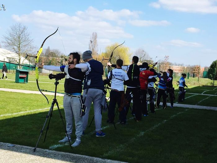 Archery field training. Archery Archery Competition Archery Training Sportsman Sport Match - Sport Full Length Sports Team Men Practicing Sky Grass