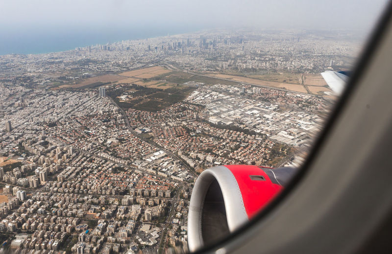 Tel Aviv, Israel, May 01, 2019 : View of Tel Aviv city from the window of a flying airplane, Tel Aviv in Israel Day Outdoors Mediterranean Sea Coast Tel Aviv Israel Suburb Travel Destinations Vacation Flight Tourism Airplane Trip Transport Water Panorama Departure Cityscape Embankment Sky Airport Comfort Building International Technology