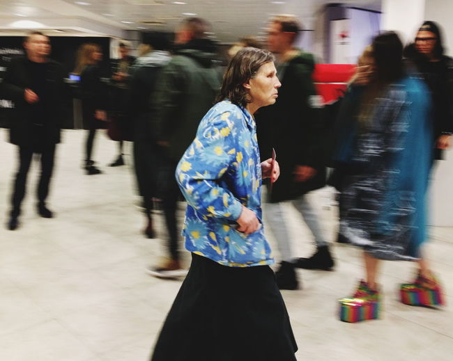 Blurred motion of woman using mobile phone in city