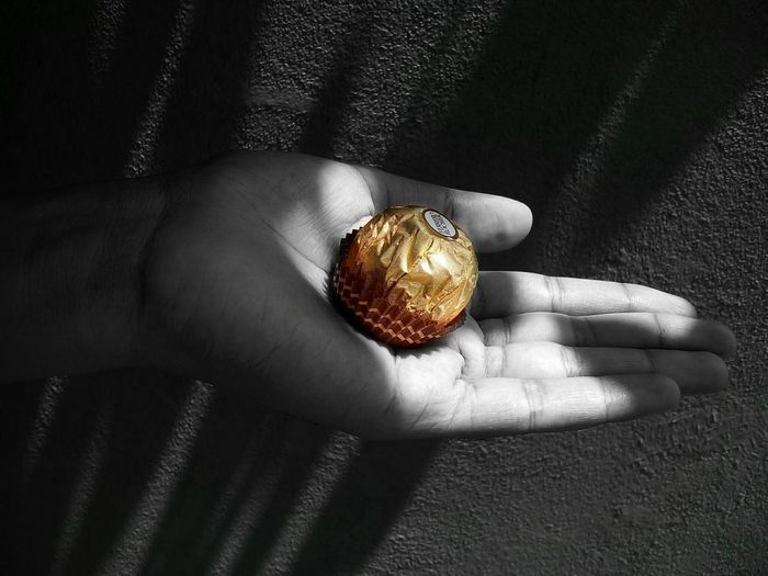 43 Golden Moments Ferrero Rocher Ferrerorocher Chocolates Natural Light Lights And Shadows Human Hand Gold Color Gold Package Golden Paper Gold Color Paper Packing Popular Interesting Sweet Sweet Treats  Yummy Food Photography Food Showcase July Black And Gold Black And White My Edit Colorsplash Fine Art Photography The Magic Mission