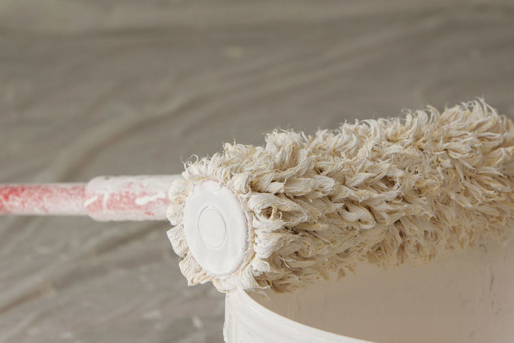 Close-Up Of Paint Roller On Bucket