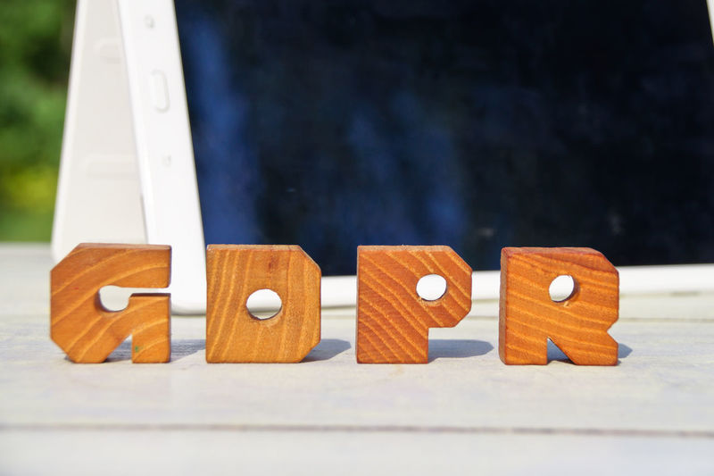 Close-up of wooden alphabets on table