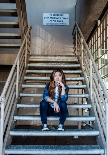 Portrait Of Confident Stylish Woman Sitting On Steps