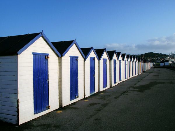 Row of huts in Paignton, Devon Learn & Shoot: Leading Lines Paignton Paignton Beach Devon Huts Huts And Sky Beach Huts Beachhutstyle Seashore Rows Of Things By The Sea Rows Beachhuts Blue Beautifully Organized