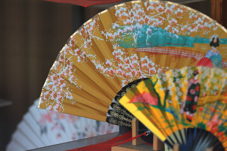 Close-Up Of Patterned Hand Fans For Sale At Market