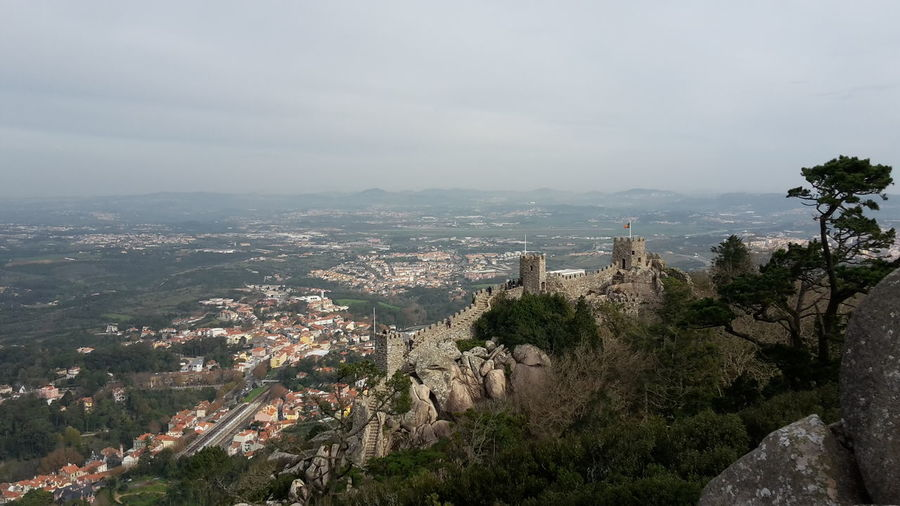 High angle view of castle on hill against sky