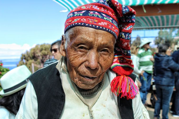 head of the island of Taquila. Portrait Smiling Looking At Camera Headshot Warm Clothing Cheerful Happiness Human Face Front View