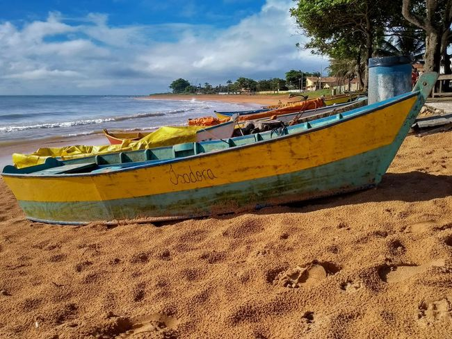 Boats at Manguinhos EyeEmNewHere Beach Sand Sea Water Day Tree Sky Outdoors Nature No People Vacations First Eyeem Photo