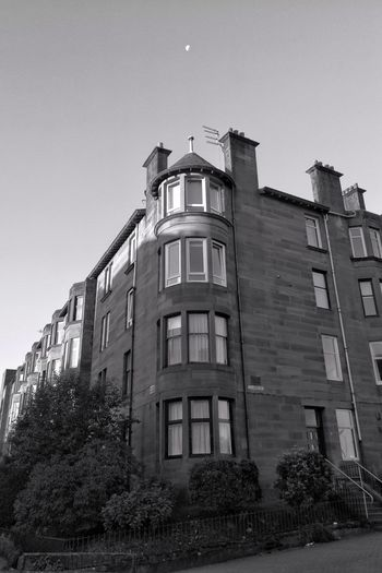 Architecture Built Structure Building Exterior Low Angle View Destruction No People Day Outdoors Sky Shadows Shadow And Light Tenements Clear Sky Blackandwhite Photography Black And White Morning Moon Streets Of Glasgow Shoot For The Moon !