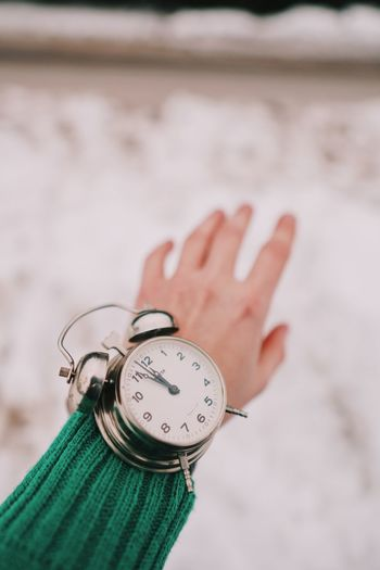 Winter Human Hand Hand Human Body Part One Person Watch Focus On Foreground Time Close-up Finger Human Finger Wristwatch Body Part Instrument Of Time Real People Indoors  Personal Accessory Clock