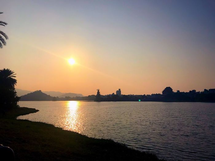 Water Sky Sunset Sunlight Reflection Nature Scenics - Nature Sun