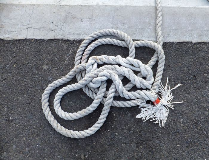 Close-up of rope tied on ground